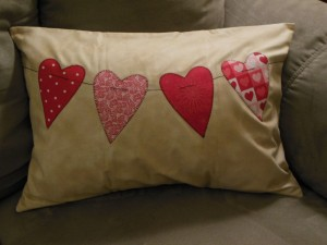 String of hearts pillow